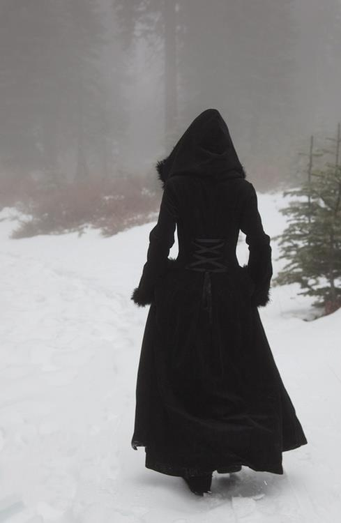 black cloaked woman